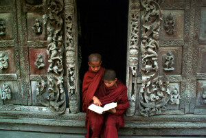 Young monks reading a book at Shwenandaw Monastery in Mandalay,M